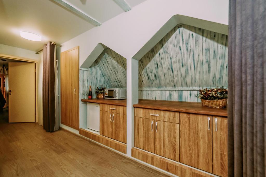 Кухня или мини-кухня в Hotel Berezka