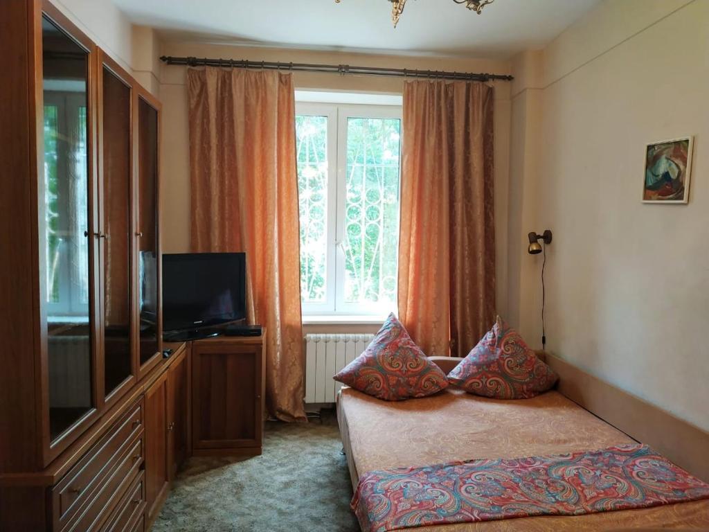 Телевизор и/или развлекательный центр в Apartment on Khoroshevskiy proyezd