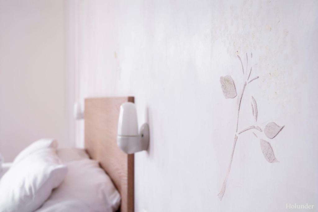 Ein Bett oder Betten in einem Zimmer der Unterkunft Hotel Tafelfreuden