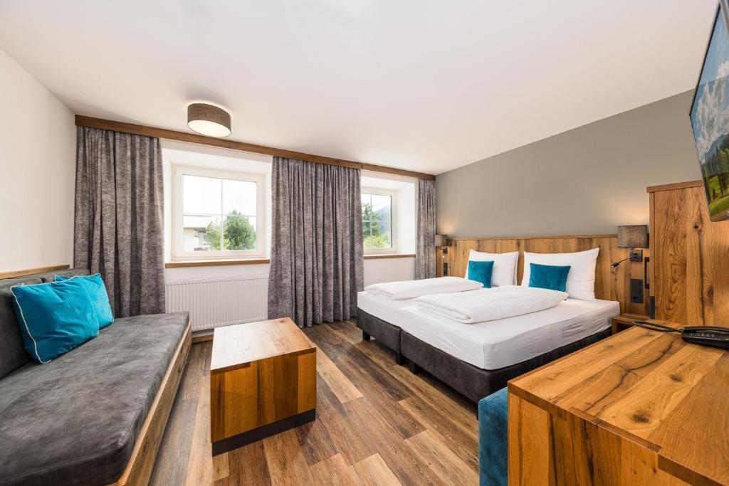 Ein Bett oder Betten in einem Zimmer der Unterkunft Hotel Bräurup