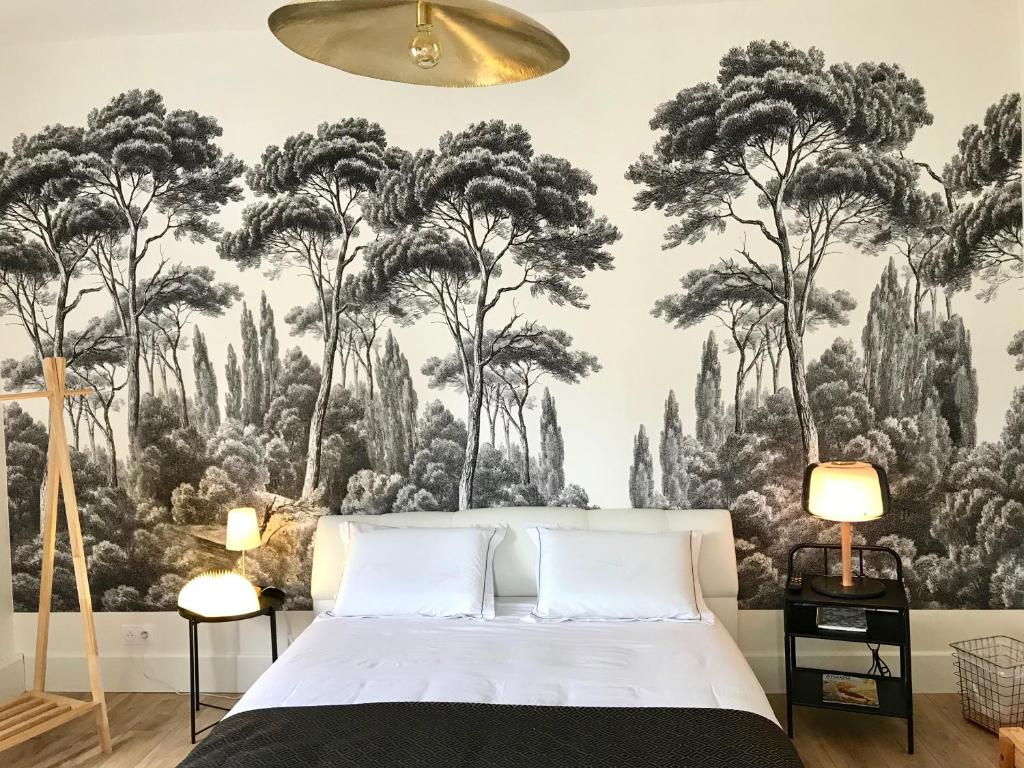 A bed or beds in a room at La Lambertine & Spa