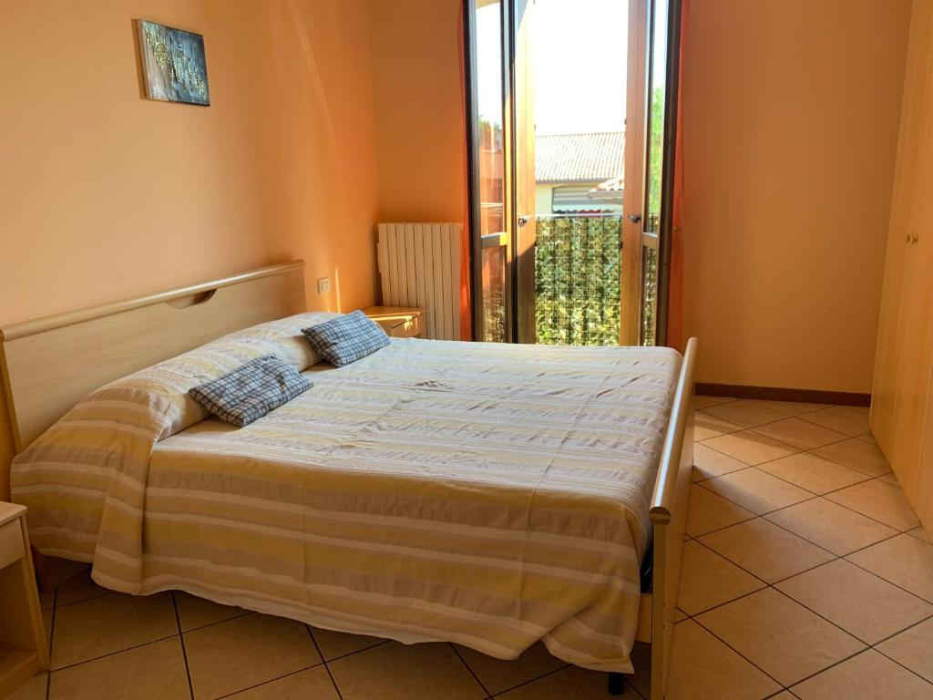A bed or beds in a room at Apartment Orio 3