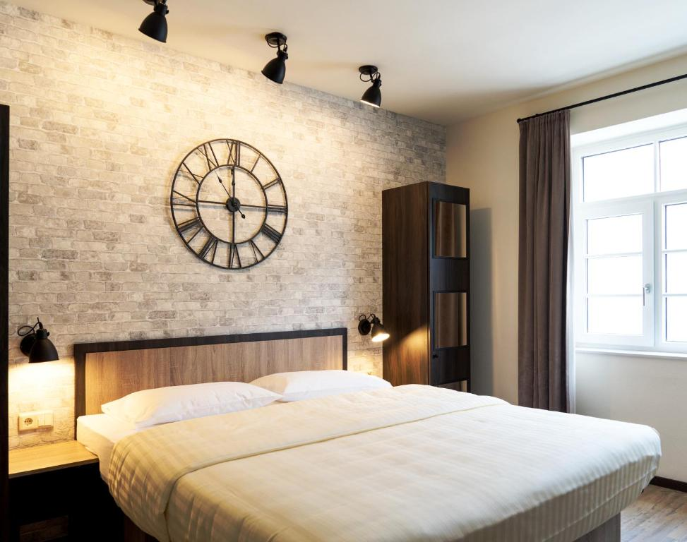 A bed or beds in a room at Loft Collection Salzburg Mirabell contactless check-in