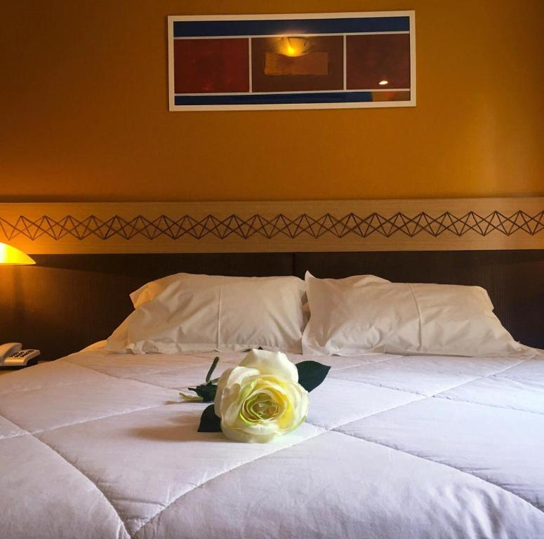 A bed or beds in a room at FLAT LUXO MountainVillage