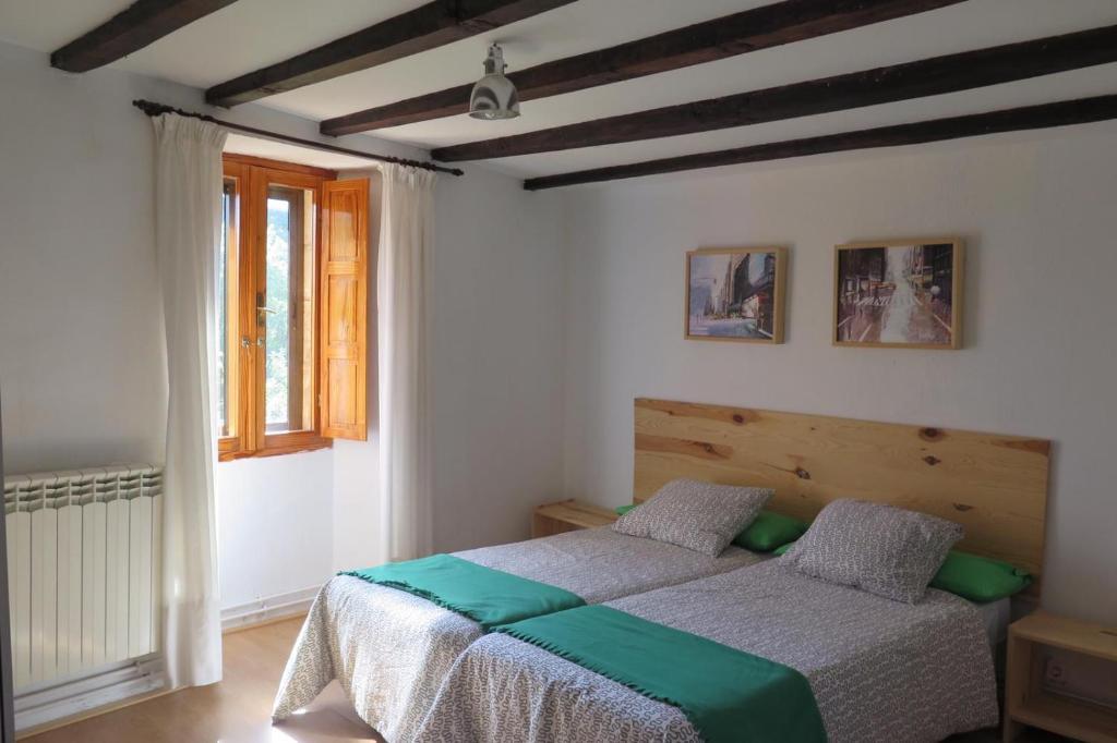 A bed or beds in a room at Albergue Turístico La Casa del Páramo