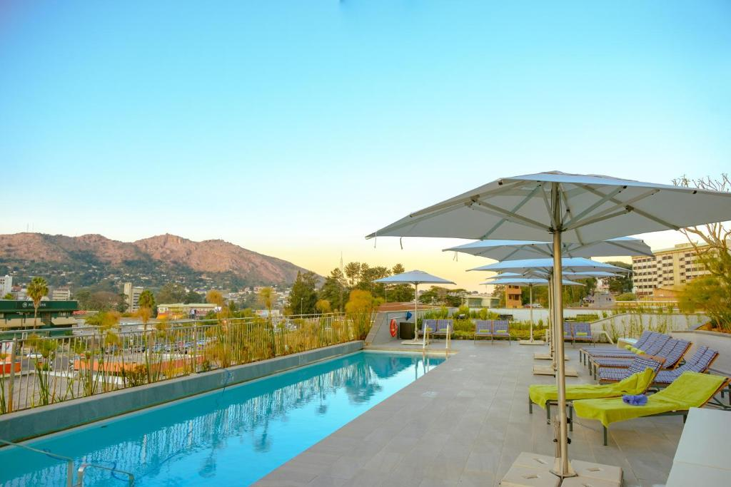 The swimming pool at or near Hilton Garden Inn Mbabane