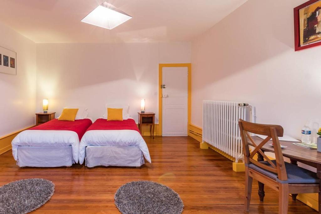 Un ou plusieurs lits dans un hébergement de l'établissement Chambres d'Hôtes La Corne aux Vaches
