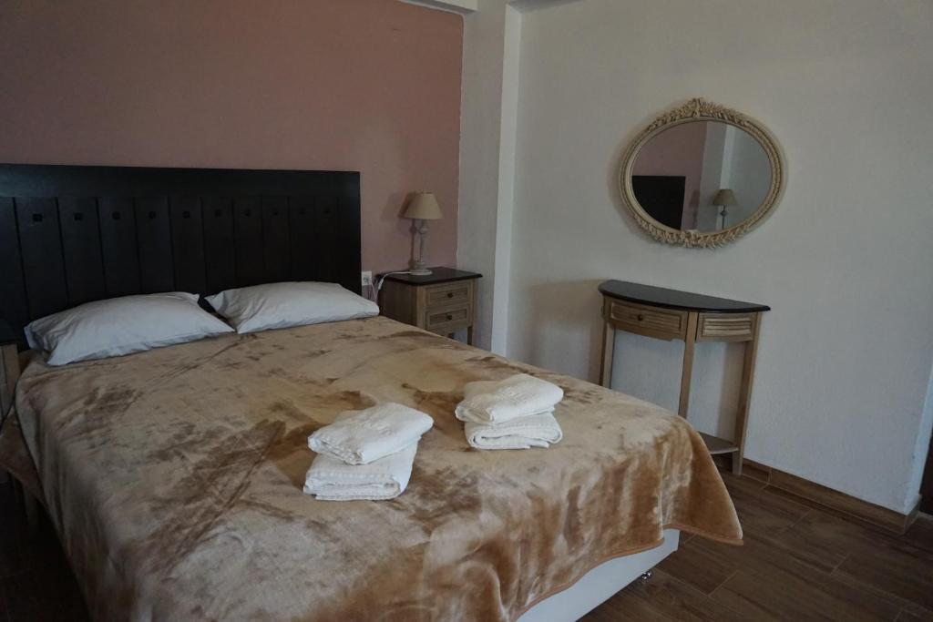 Ένα ή περισσότερα κρεβάτια σε δωμάτιο στο Κέδρος