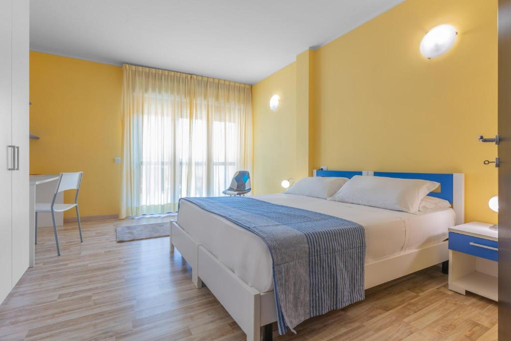 A bed or beds in a room at Asso Residence