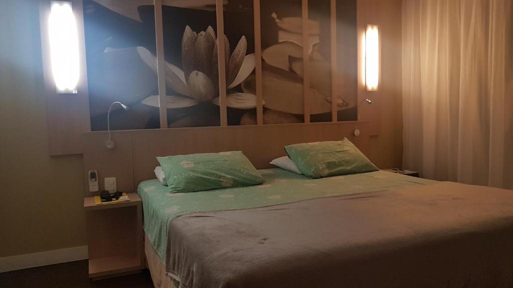 Cama o camas de una habitación en Flat Manaus