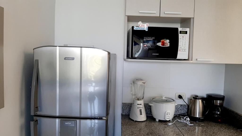 A kitchen or kitchenette at Apartamento en Country Club Miraflores PIURA