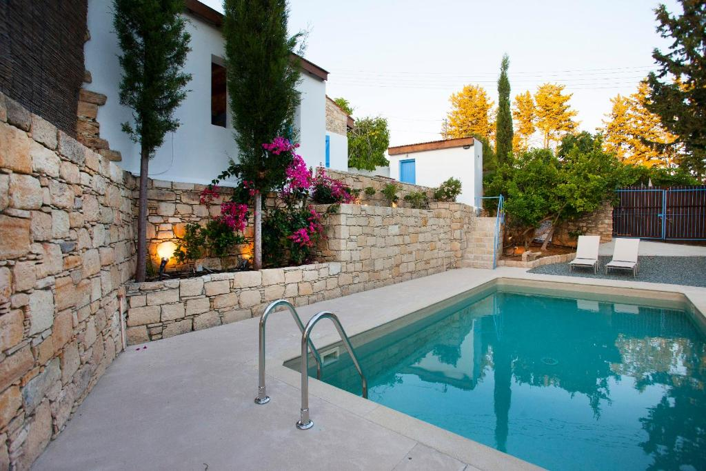 The swimming pool at or near Cecilias Courtyard
