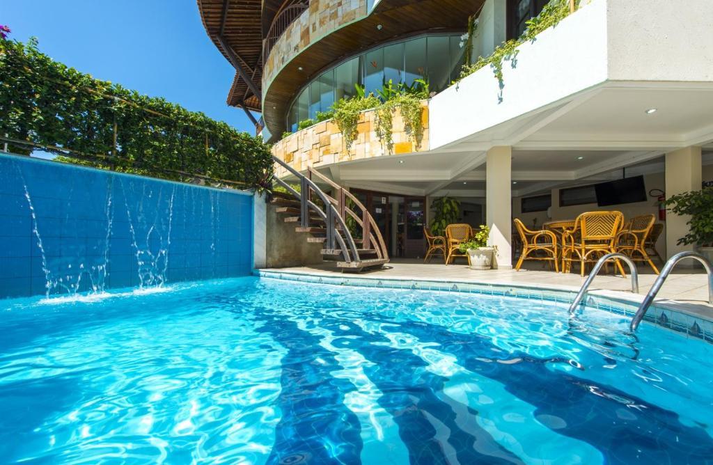 The swimming pool at or close to Divi-Divi Praia Hotel