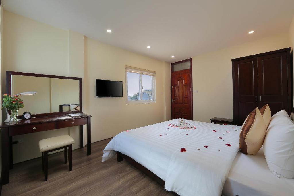 Ein Bett oder Betten in einem Zimmer der Unterkunft Spoon Hotel
