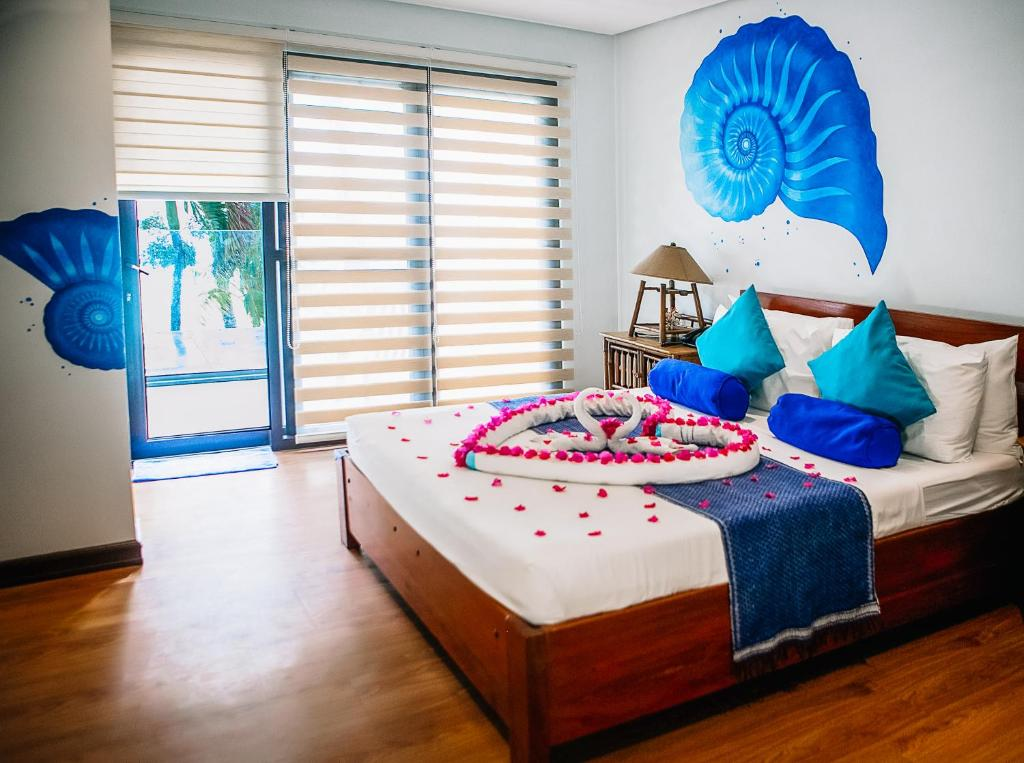 A bed or beds in a room at 357 Boracay Resort