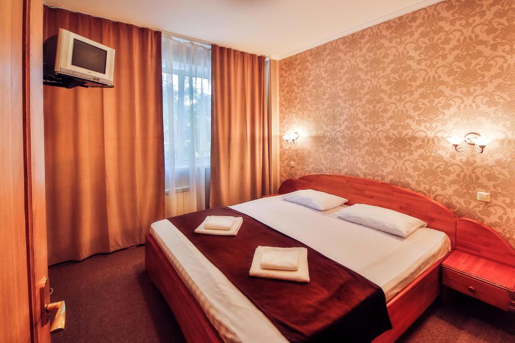 Кровать или кровати в номере Tet-a-Tet Guest House