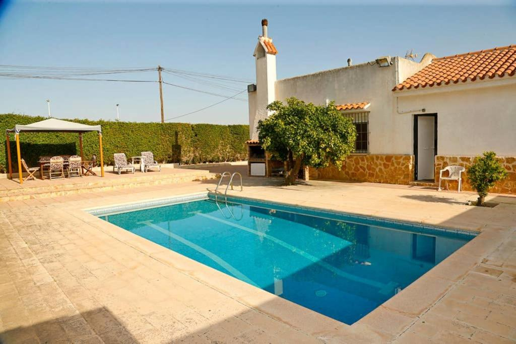 The swimming pool at or near Arenales Great Home with AC, Pool and Barbecue