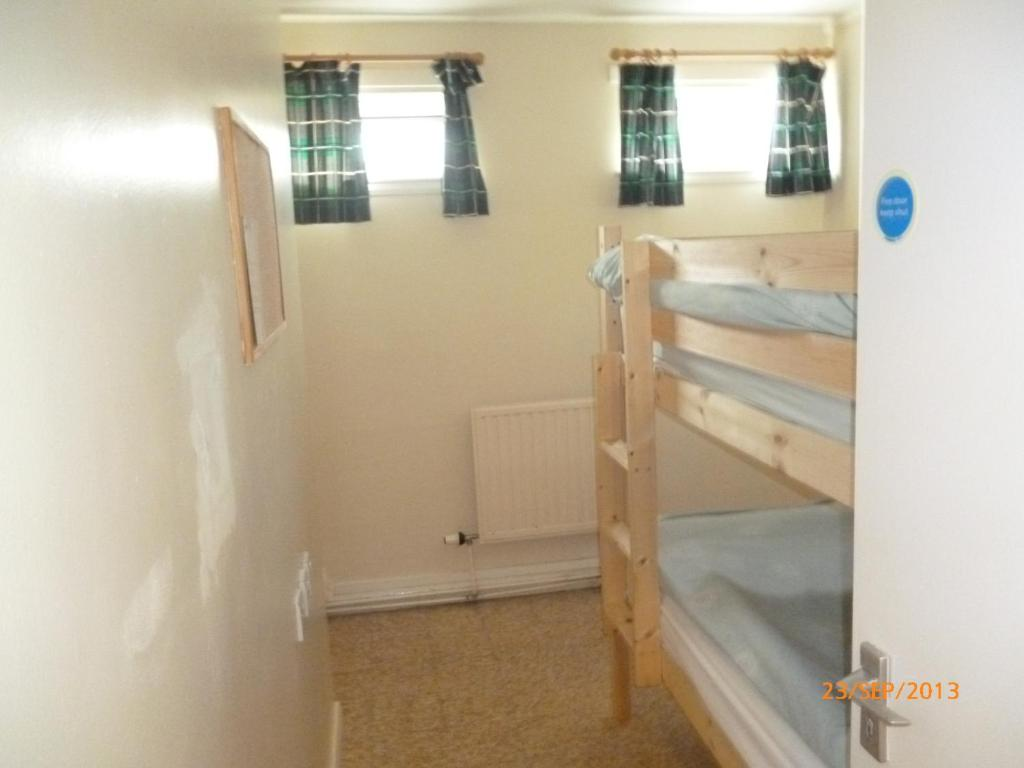 A bunk bed or bunk beds in a room at The Mission Bunkhouse