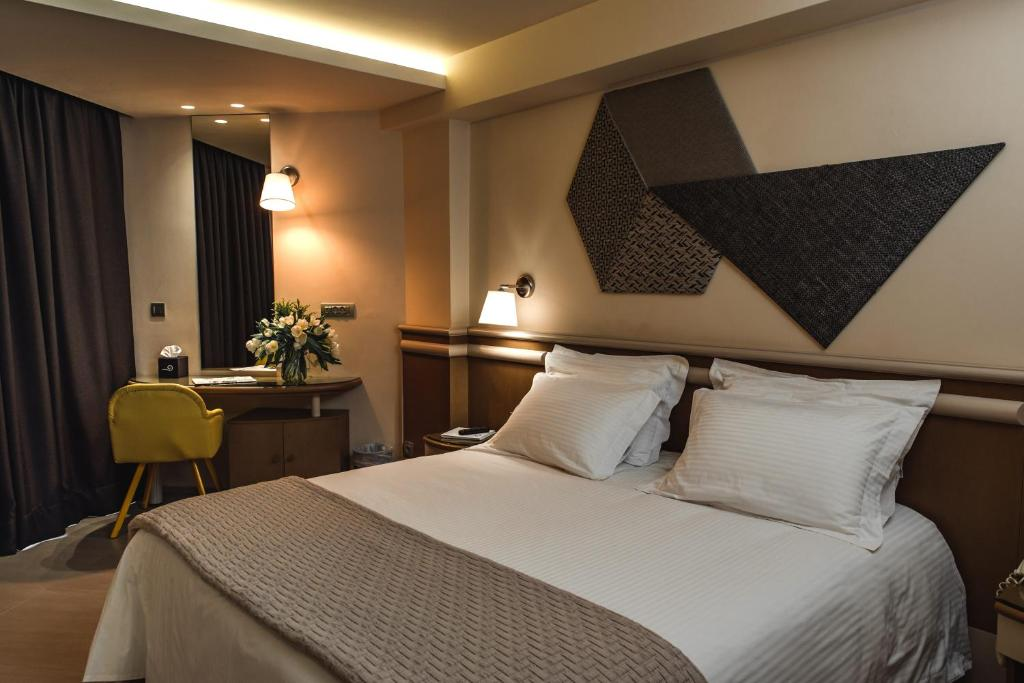 A bed or beds in a room at Emmantina Hotel