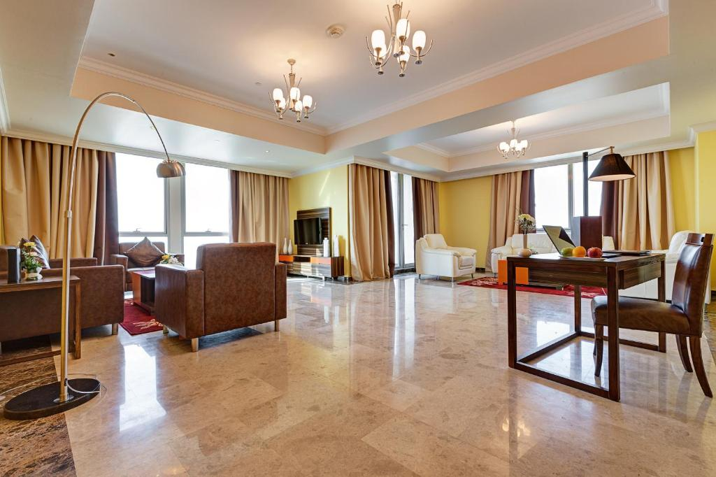 A seating area at Abidos Hotel Apartment Dubai Land