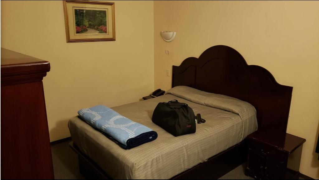 Cama o camas de una habitación en BONITTO INN® Mante