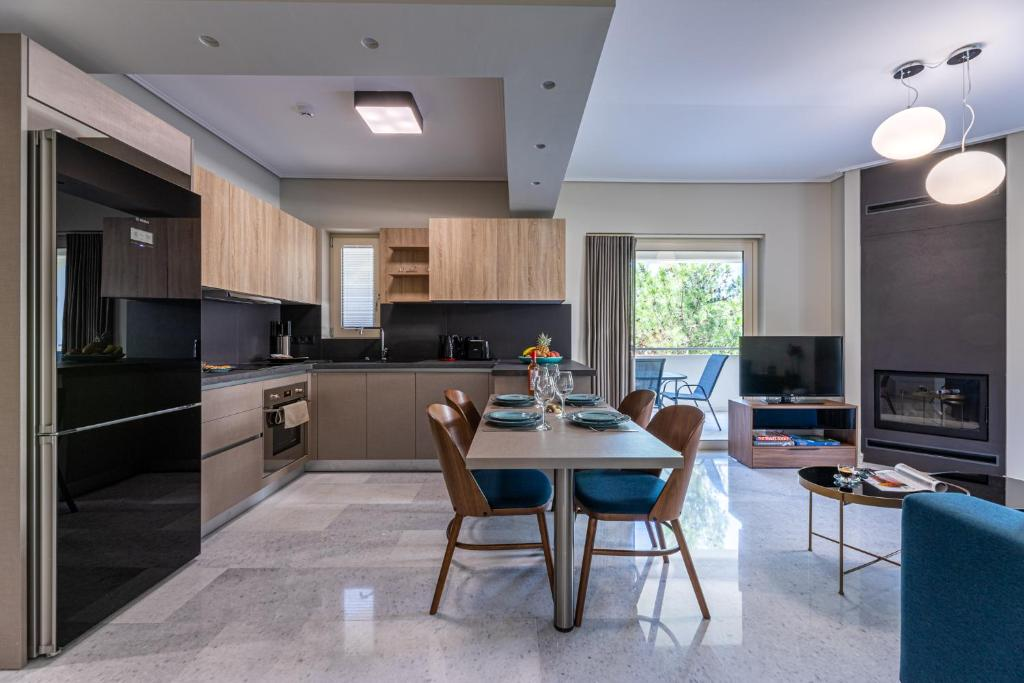 A kitchen or kitchenette at Olygreen Athens Residences