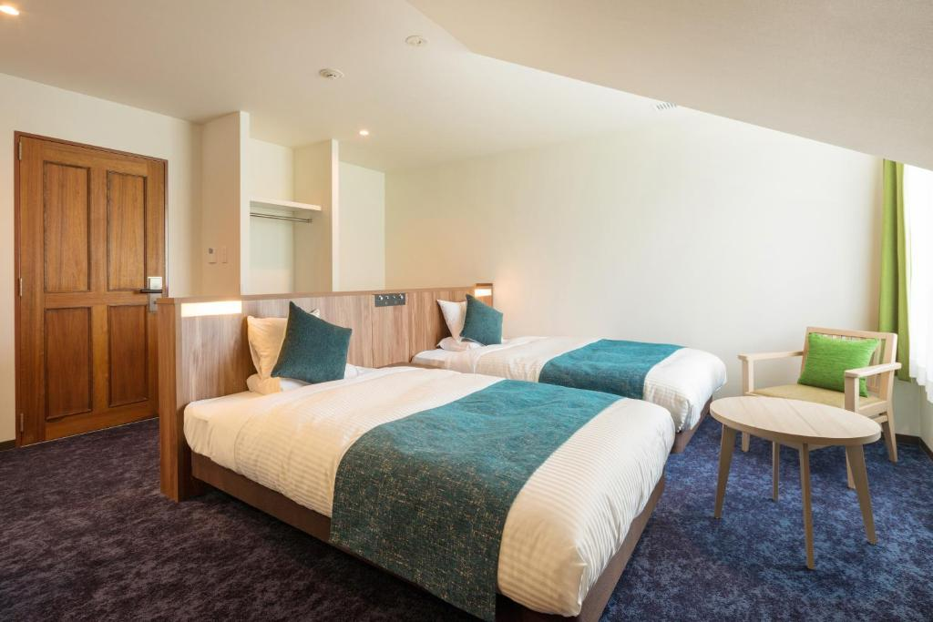 A bed or beds in a room at Tazawako Lake Resort & Onsen