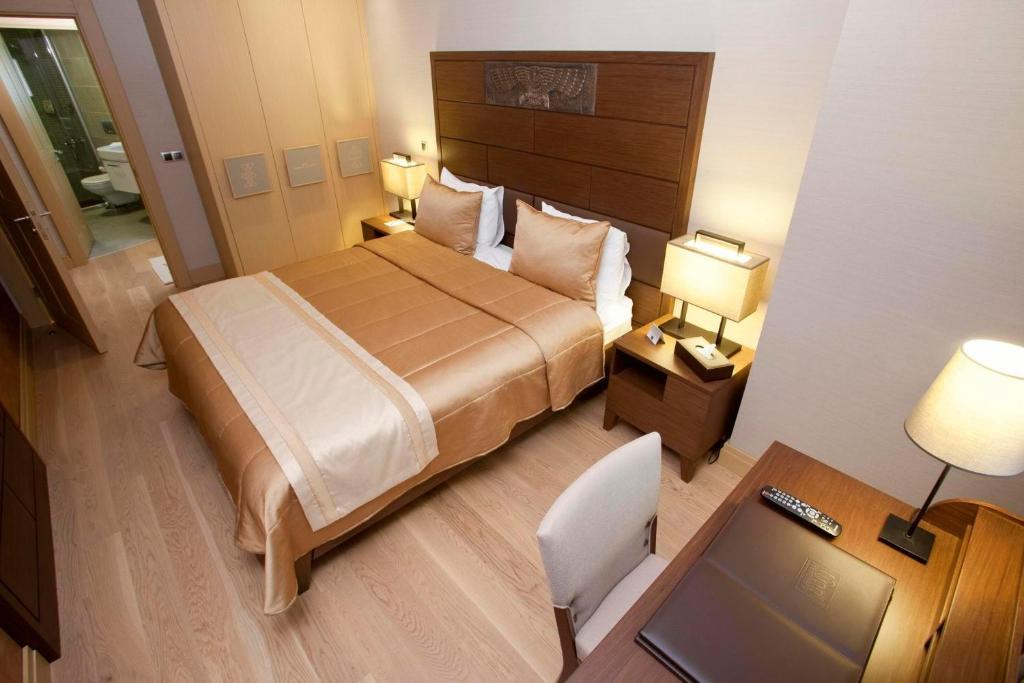 Кровать или кровати в номере Tunel Residence
