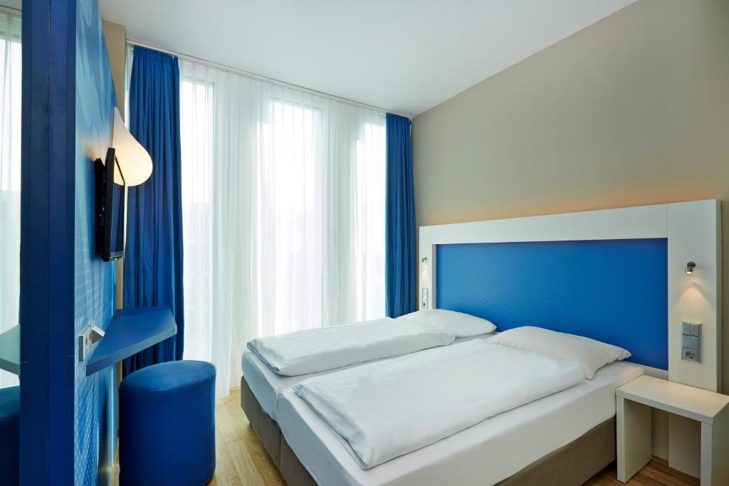 Posteľ alebo postele v izbe v ubytovaní H2 Hotel München Messe