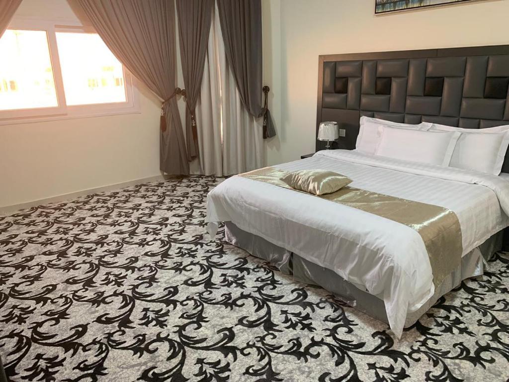 Cama ou camas em um quarto em Milaf Hotel Apartments