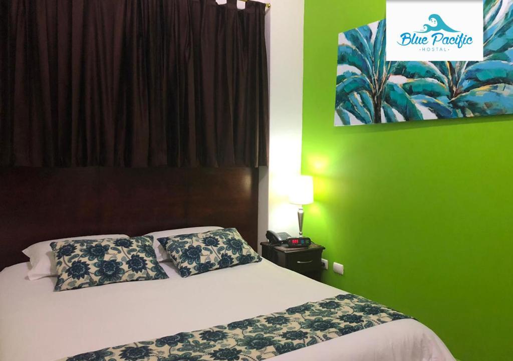 Cama o camas de una habitación en Hostal Blue Pacific