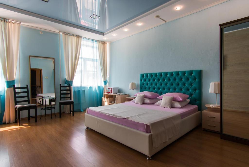 Кровать или кровати в номере Hotel Business-Turist