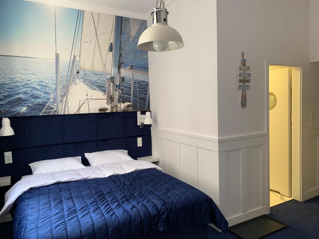 Łóżko lub łóżka w pokoju w obiekcie Pokoj Pod Żaglami