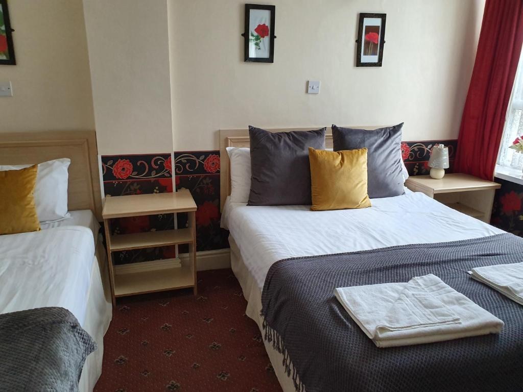 A bed or beds in a room at The Allendale