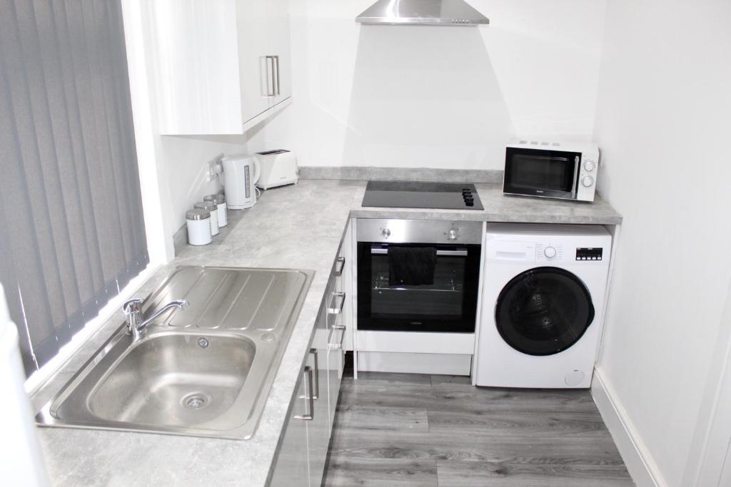 A kitchen or kitchenette at Reads Luxury Jacuzzi Apartments