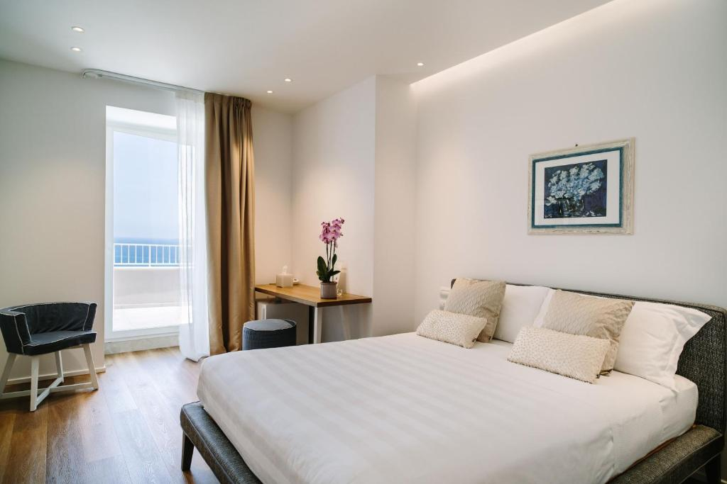 A bed or beds in a room at NUMA HOTEL