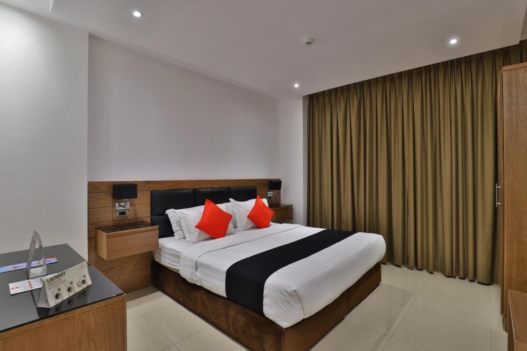 Cama ou camas em um quarto em Sendan Residence