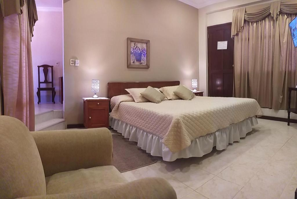 A bed or beds in a room at Hotel Carmen