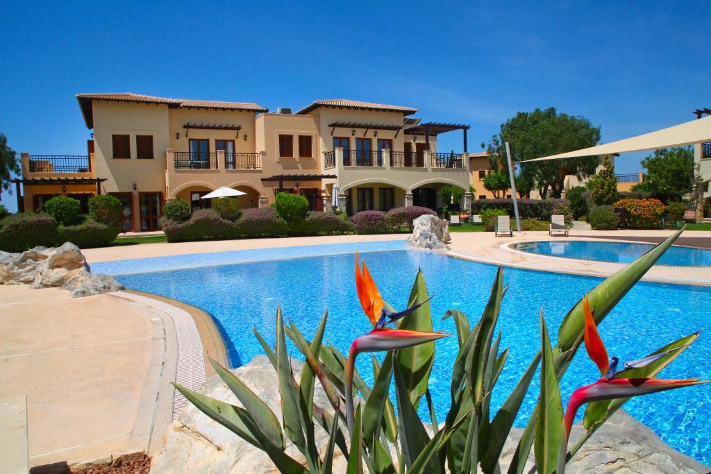 The swimming pool at or near Aphrodite Hills Golf & Spa Resort Residences – Apartments