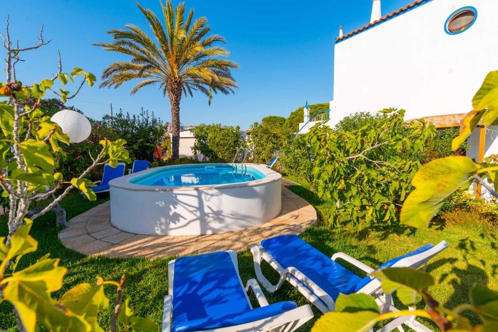 The swimming pool at or near Casa Algarvia