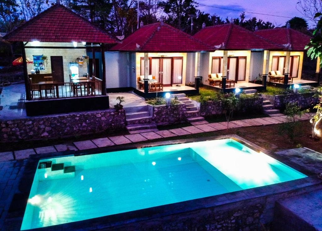A view of the pool at Kampuak Cottages or nearby