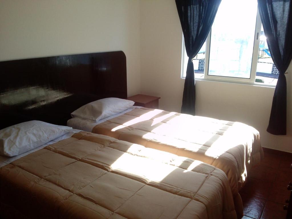 Uma cama ou camas num quarto em Apartamentos Lisboa