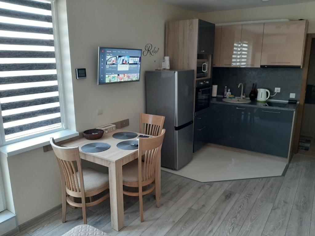 Кухня или кухненски бокс в Apartment RELAX