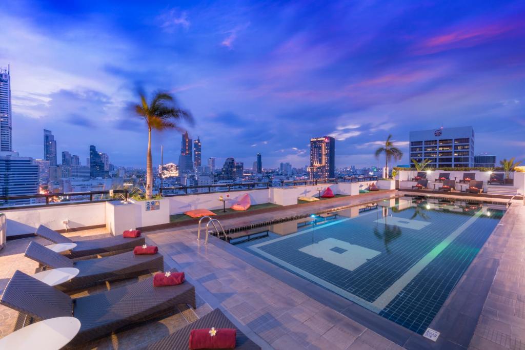 The swimming pool at or near Furama Silom Hotel