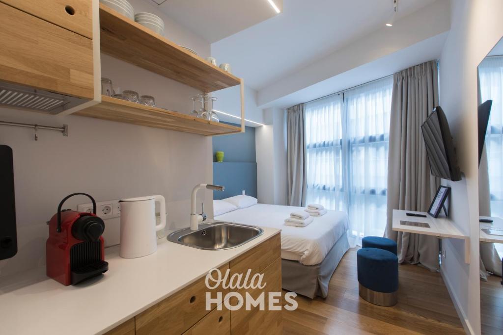 A kitchen or kitchenette at Olala Syntagma Apartments