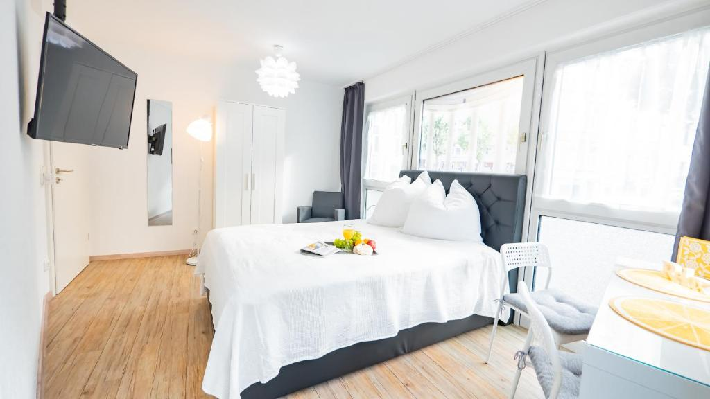 A bed or beds in a room at Relax Aachener Board Appartements Phase 4