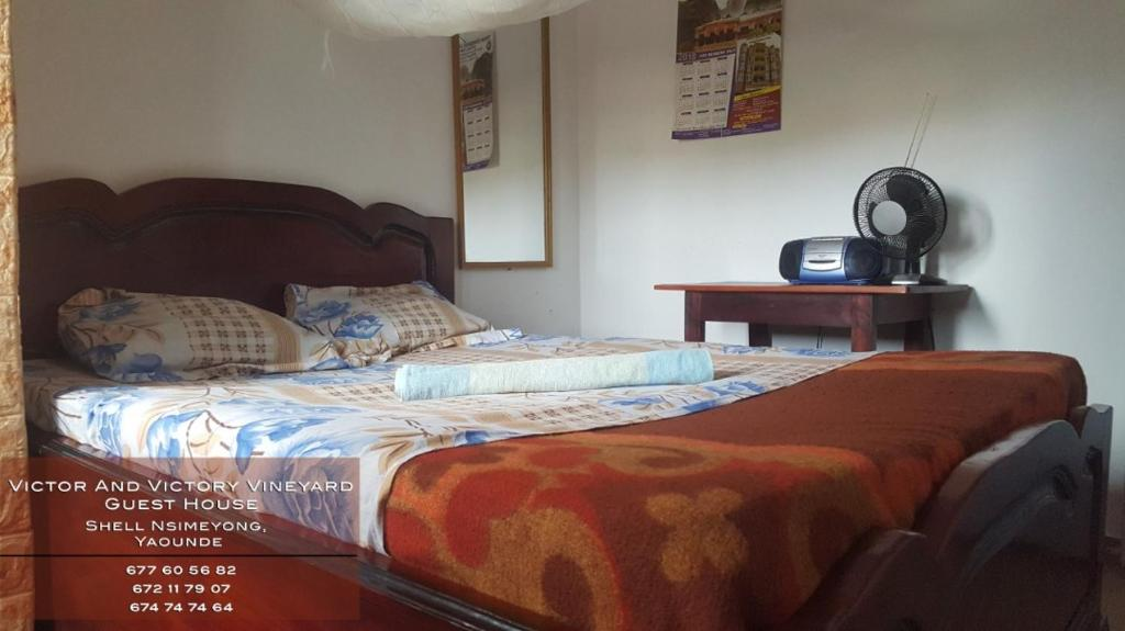 A bed or beds in a room at VICTOR AND VICTORY GUESTHOUSE Annexe