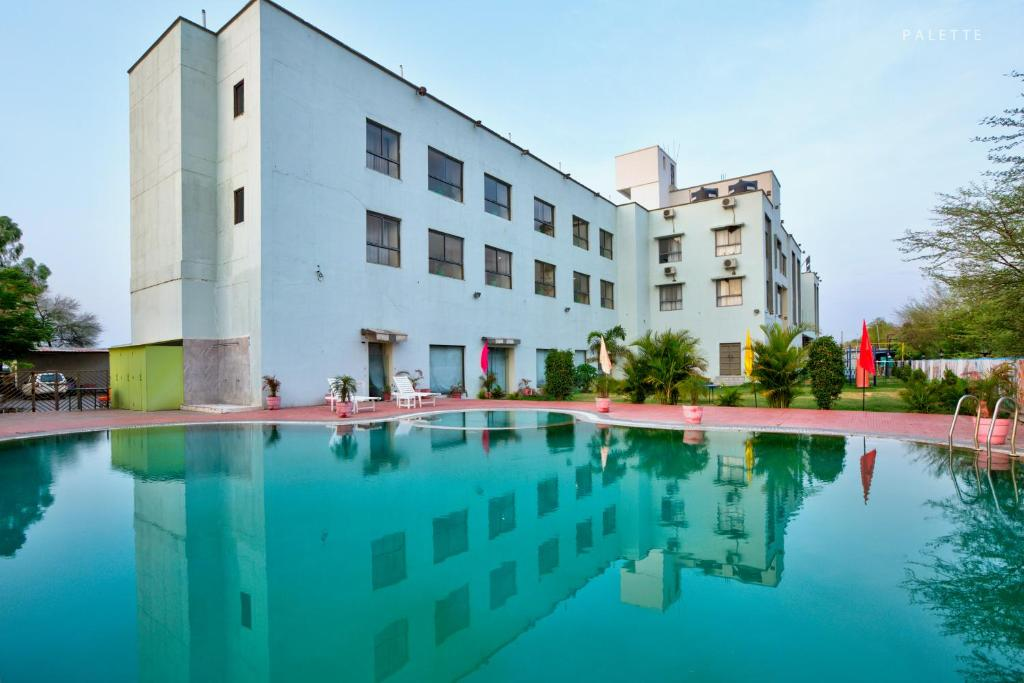The swimming pool at or close to Hotel Amrit Manthan