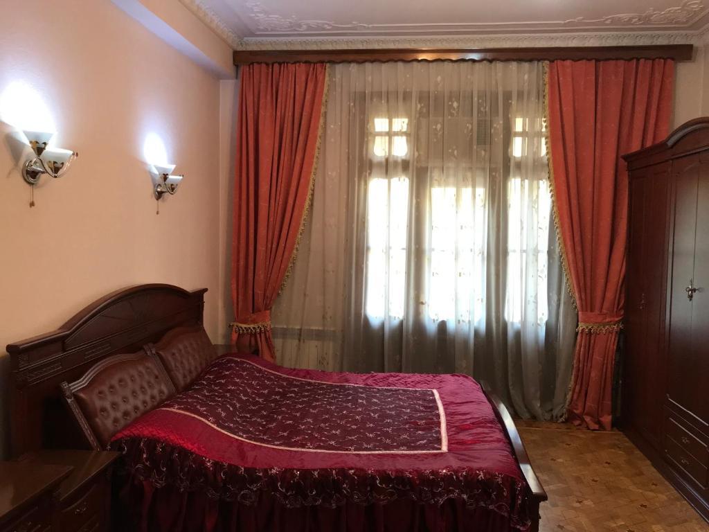 Cama ou camas em um quarto em Sahil Boulevard Apartament