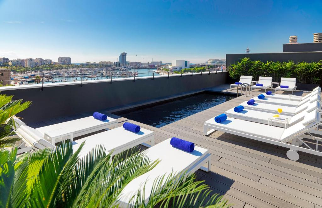 The swimming pool at or near H10 Port Vell 4* Sup